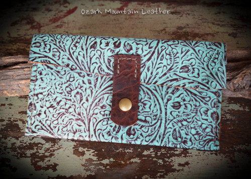 Turquoise leather wallet with divided money sections great for the envelope system.