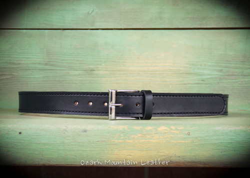 Classic belt shown here in black.  Has silver tone buckle made from brass.  Double layer of leather built to last.