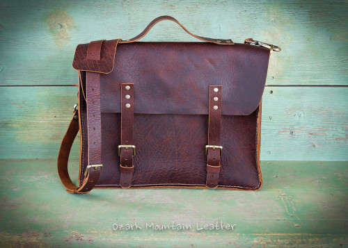 Bison leather messenger bag handmade by Ozark Mountain Leather in brown.  Perfect for business or school use.  Can be worn cross body or over the shoulder.