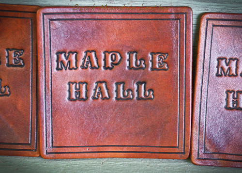 Custom Leather coaster set shown in dark brown.