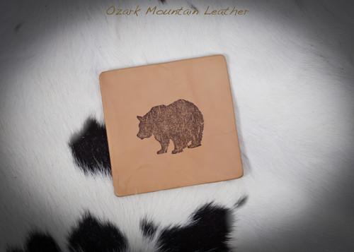 Bear design leather coaster set.