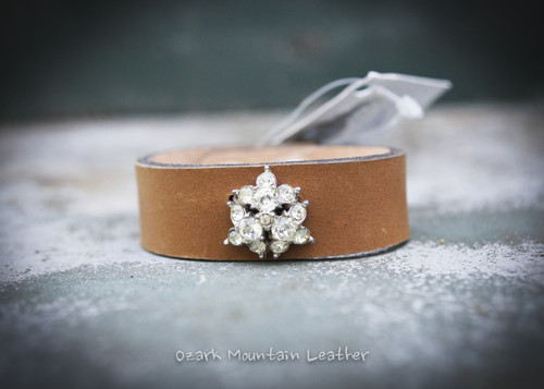 Vintage clear rhinestones on brown leather cuff.
