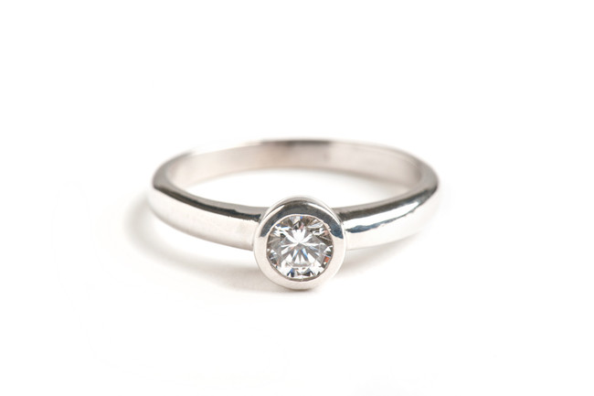 14kt white gold round brilliant cut diamond solitaire engagement ring.  Contact us for exact pricing and diamond information. This ring can be made in any combination of stone size and metal type.  Starting at $1500.