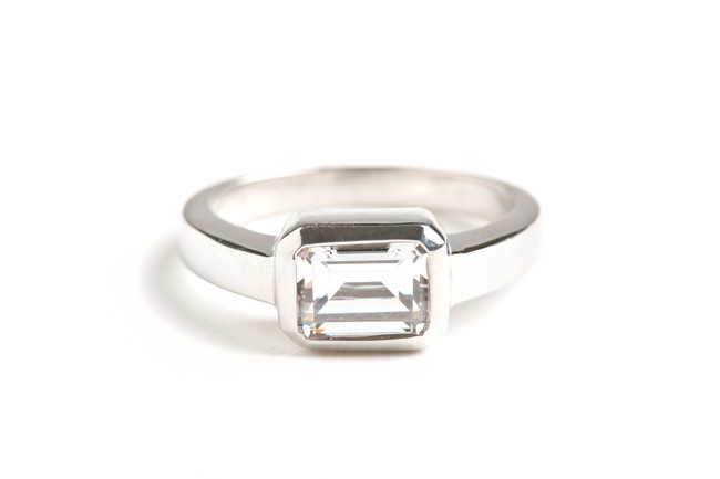 14kt white gold emerald cut diamond solitaire engagement ring.  Contact us for exact pricing and diamond information. This ring can be made in any combination of stone size and metal type.  Starting at $1500.