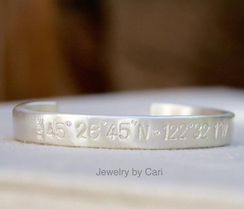 This cuff is stamped with Large numbers.