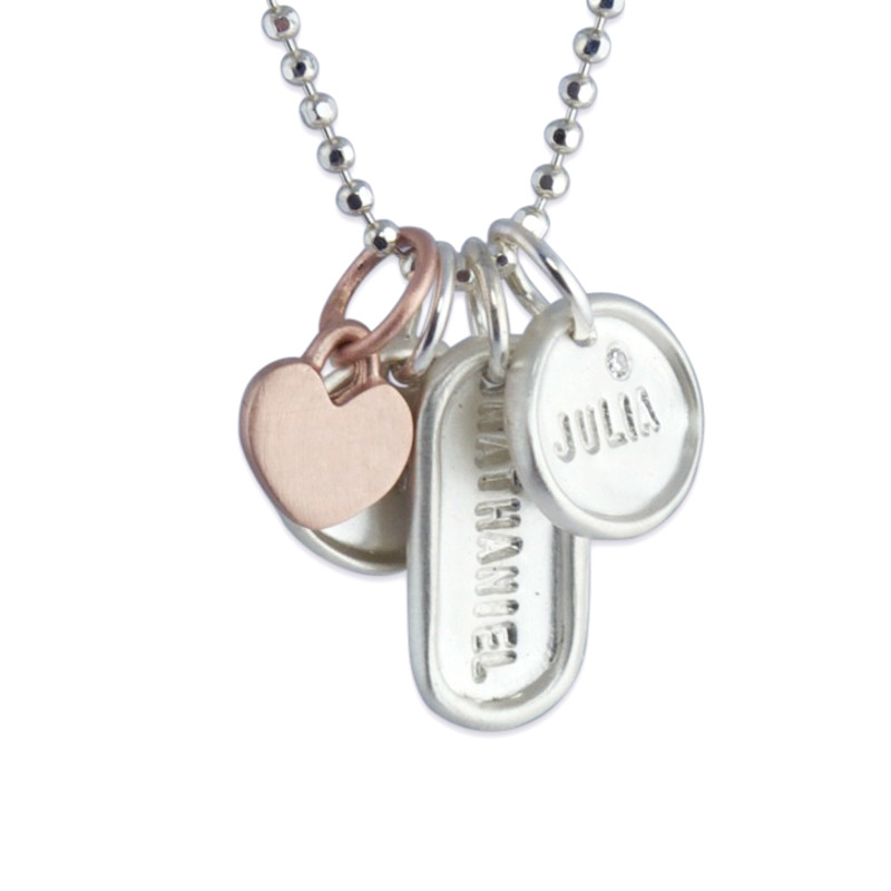 itty bitty pink gold heart with a tiny dog tag and 2 tiny discs