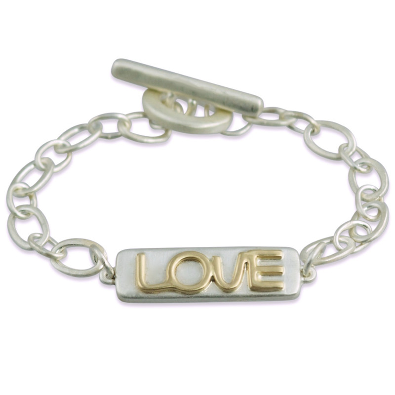 with raised yellow gold letters LOVE
