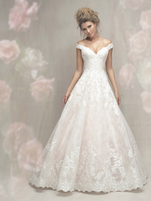 This timeless ballgown balances a simple silhouette with romantic lace throughout.