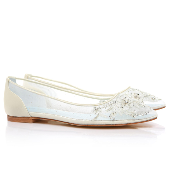 Adora 'Eternal' bridal collection Romantic mesh flats with floral beading Hand beaded and embroidered Swiss dot beaded effect across the sides Soft and comfortable modern glass slippers Silk piped Almond toe Ivory color Imported silk upper Flat Handmade Imported 'something blue' leather lining Imported leather sole Heavy padding for all-day comfort Sizing runs true to size