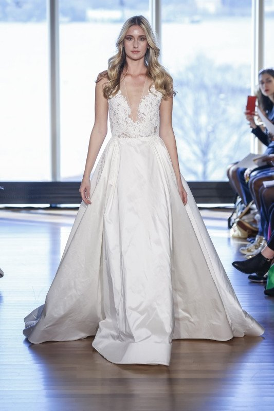 Rivini Bridal Stevie Pleated ball gown with corded lace bodice that fades onto shoulders and opens into a keyhole back.