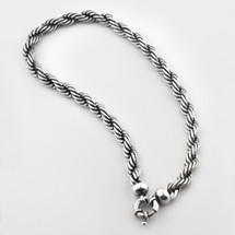 Twisted rope necklace in burnished silver with smooth caps. Finished with a signoretti clasp.