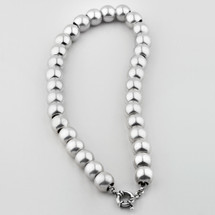 Luminescent silver bead necklace. Finished with a signoretti clasp.