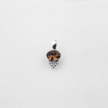 Petite smoked topaz Swarovski® crystal pendant with filigree detail.