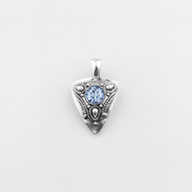 Eclectic burnished silver pendant with a light sapphire Swarovski® crystal centre