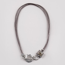 Light brown leather necklace embellished with burnished silver plated details. Length: 45 cm