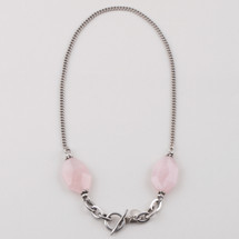 Burnished silver plated link and chain necklace embellished with dusty rose stones