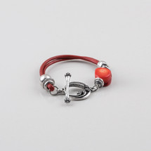 Red leather and detailed burnished silver plated bracelet with T-bar and fob. Length 19 cm