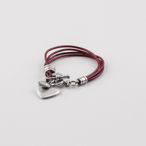 Red leather and burnished silver plated bracelet with heart charms finished with a T-bar and fob. Length 19.5 cm