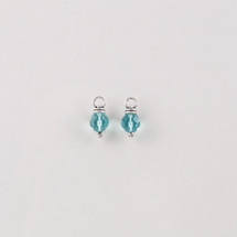 Burnished silver Pretty Woman charm earrings adorned with turquoise beads