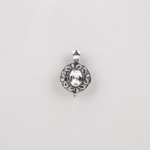 Plated burnished silver filigree pendant with a classic Swarovski® crystal centre.