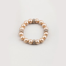 Champagne shell pearl stretch bracelet with golden shadow Swarovski® crystals