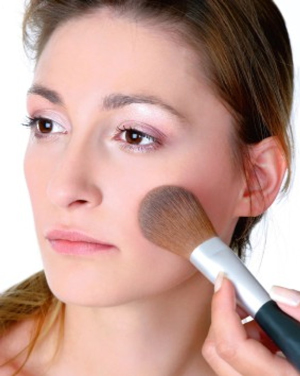 A little goes a long way. Tap the loose minerals from your brush. Only a small amount should cling to the brush before applying. You can also use a cosmetic wedge.