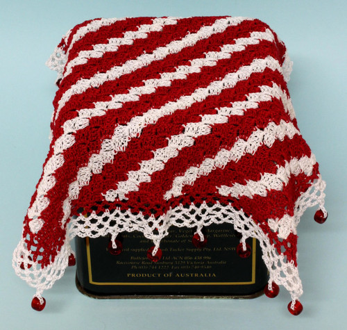 Crocheted jug cover, worked from corner to corner.