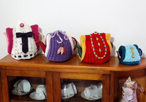 CMPATK005 Craft Moods knitting pattern for Roll-up Your Sleeves Tea Cosy with 5 pattern variations in 4 sizes