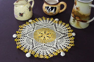 CMPATC099 crocheted circular fan design jug cover.