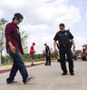 Performing a one legged-stand test which is a field sobriety test while wearing a Drunk Busters Impairment Goggle.