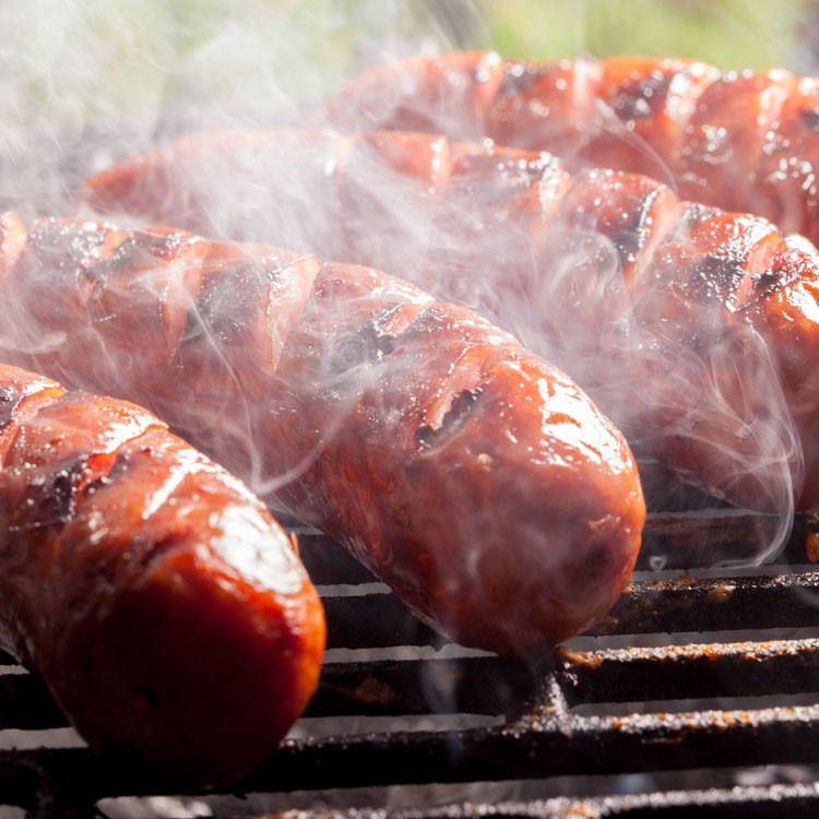 sausage grilling on the barbecue