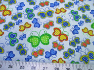 Discount Fabric Quilting Cotton Multi-Colo?red Butterflie?s on Light Blue 402K