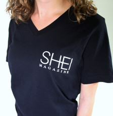 100% cotton, black, v-neck, ladies t-shirt with small SHEI logo on upper right. Available in sizes S, M, and L