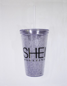 Clear plastic 16 oz. cup with straw and screw-top lid, printed with SHEI logo