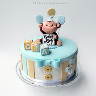 blue yellow monkey baby shower cake