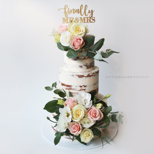 semi naked wedding cake with fresh flowers