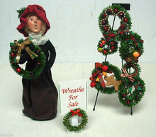 WOMAN SELLING WREATHS