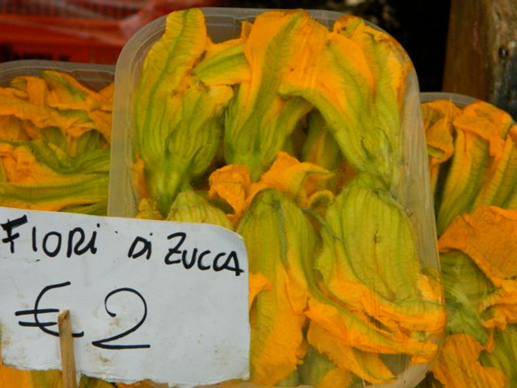 Zucchini blossoms at a farmers market in Tuscany.