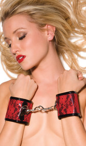 Vinyl and red lace wrist cuffs with hook and loop closure around wrists. They hook together and detach with swivel bolt snap hooks. Pair.