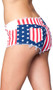 Low rise mini jean shorts feature American Flag design, a zipper fly with button closure, five pockets, belt loops and frayed edges.