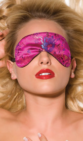 Luscious pink brocade blindfold. Back side is felt lined. Has an elastic band that goes around the head.