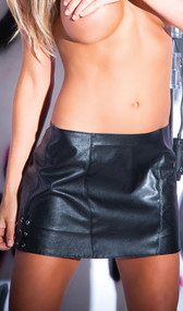 Faux leather mini skirt with lace up detail on sides.