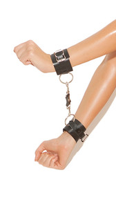 Leather wrist restraints with adjustable buckle closure. Detachable clasps on each. Stud and O-ring detail.