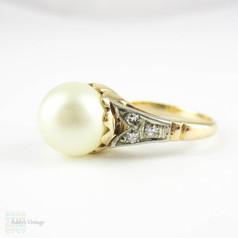 Art Deco Pearl & Diamond Engagement Ring. Large Single Pearl with Diamond Accent Leaf Design, 14 Carat & Platinum, Circa 1930s.