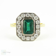 Vintage Emerald & Diamond Cocktail Ring. Deep Green Emerald Cut Emerald with Diamond Halo. 18 Carat Gold, Circa Mid 20th Century.