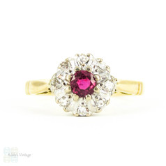 Vintage Ruby & Diamond Cluster Ring, Claw Set Ruby with Diamond Halo in 18 Carat Gold, Circa 1960s.