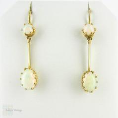Antique Opal Dangle Earrings, Double Oval Cabochon Cut Opal. Circa 1900s, 9 Carat Yellow Gold.