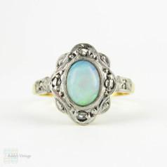 Antique Opal & Diamond Ring, Oval Cabochon Cut Opal with Diamond Halo. Circa 1910s, 18ct Gold & Platinum.