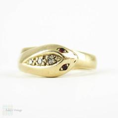Vintage Snake Ring, 9 Carat Yellow Gold with Diamond Head & Garnet Eyes. Circa Mid 20th Century.