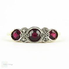 Ruby & Diamond Engagement Ring, Art Deco Three Stone Ruby Ring with Diamond Accents. Circa 1920s, 18ct & Platinum.